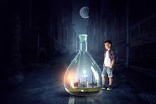 Boy Holding Glass Flask With Landscape Inside It