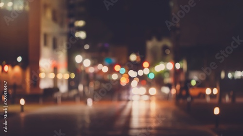 Fototapeta Abstract blur urban city street road with people walking and lighting bokeh for background. obraz