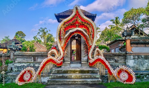 Colorful and festive traditional Balinese wedding decorations at the entrance gate of the bride's family home, near Ubud, Bali Wallpaper Mural