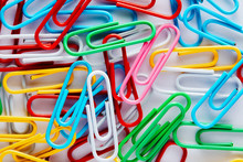 Heap Of Colorful Paper Clips.