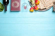 Flat Lay Composition With Symbolic Pesach (Passover Seder) Items On Light Blue Wooden Table, Space For Text