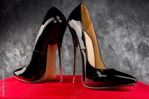 Valokuvatapetti Black fetish shiny patent leather stiletto high heels with ankle strap