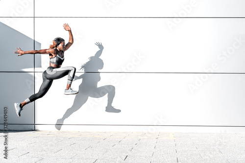 Fotografía Runner woman in motion outdoors in the city