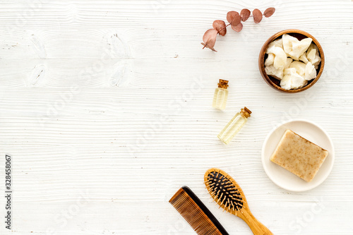 Cosmetics for hair care with argan and jojoba oil on white background top-down f Fototapet
