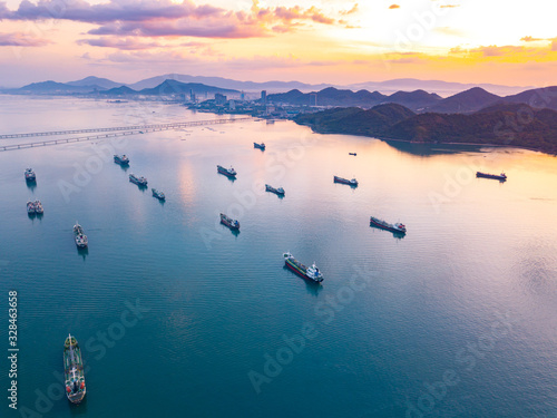 Canvastavla Aerial view from drone, Oil tanker ships off the coast in beautiful light sundown, professional business logistics and transportation of energy fuels