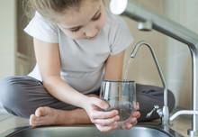 Little Girl Open A Water Tap W...