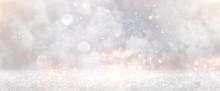 Glitter Vintage Lights Background. Gold, Silver And White. De-focused