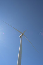 Wind Turbine Moving Blades With Blue Sky
