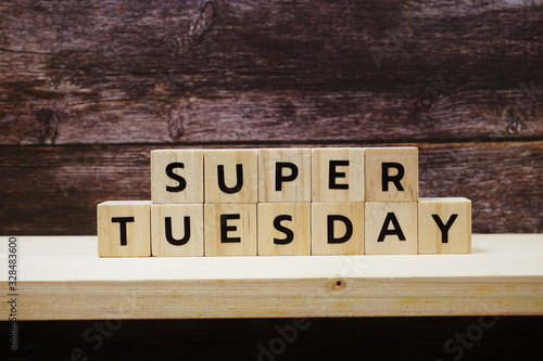 Fotografia, Obraz Super Tuesday alphabet letter on wooden background