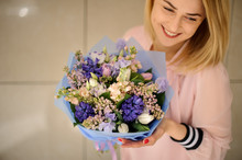 Smiling Woman Holding Bouquet ...