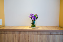 Flower In A Glass Vase On Wood...