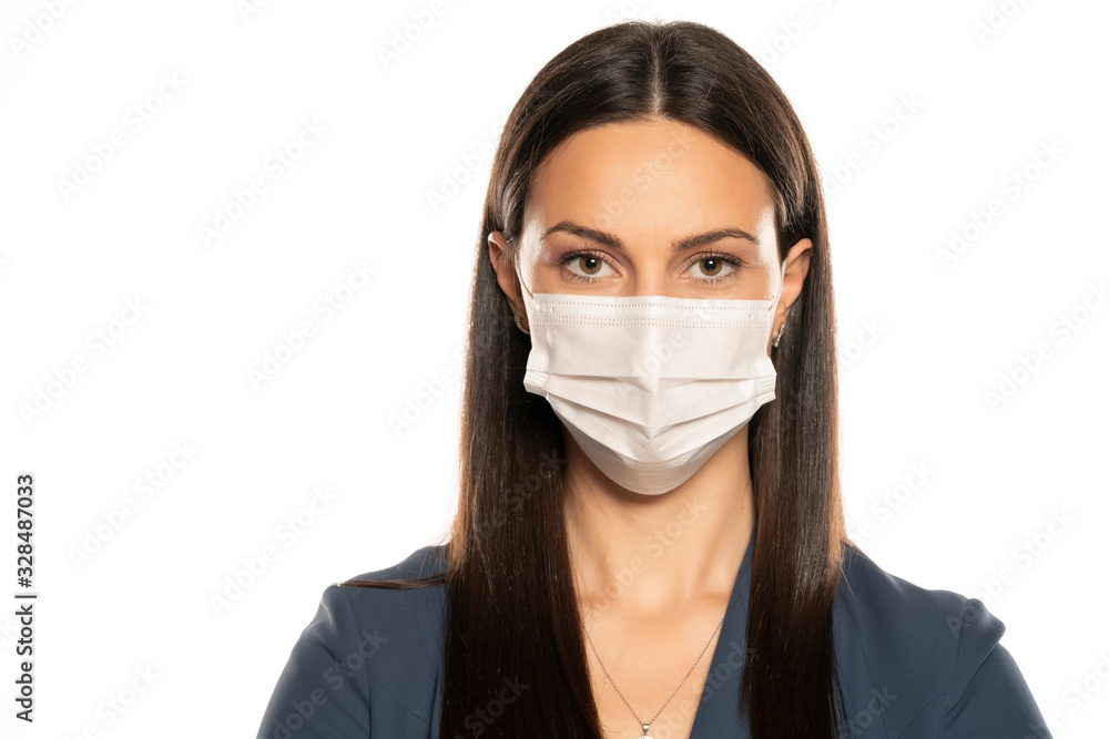 Fototapeta Beautiful young woman with protective mask on her face