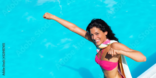 Playful young woman having fun on summer vacation at  swimming pool Tableau sur Toile