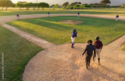 Baseball team playing in the field