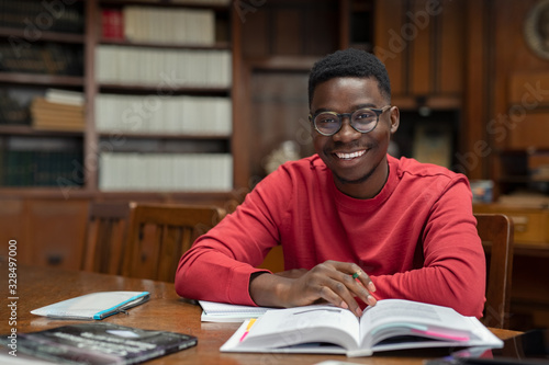 Fotografie, Obraz Happy university student in library