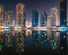 Amazing Architecture Parallel Buildings. Cloudy Night Sky. Luxury Travel Inspiration. Dubai Jumeirah Lake Towers.