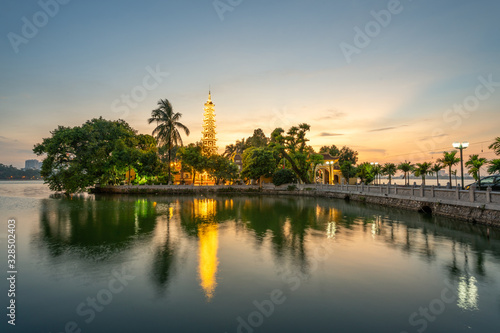 Leinwand Poster Tran Quoc pagoda, the oldest Buddhist temple in Hanoi, at twilight