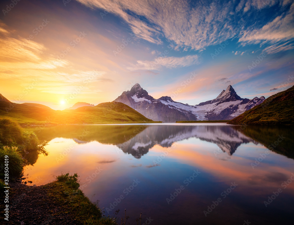 Fototapeta Magnificent panorama of the alpine lake Bachalpsee at dawn. Location Swiss alps, resort Grindelwald,