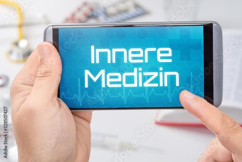 Fototapeta Smartphone mit dem Text Innere Medizin auf dem Display