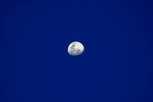Almost Full White Moon On Blue...