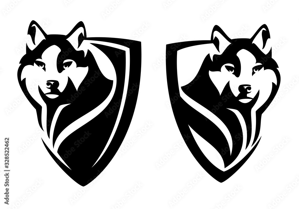 wild wolf watching attentively - animal head in heraldic shield for security concept black and white vector design <span>plik: #328522462 | autor: Cattallina</span>