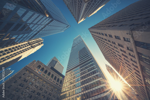 Fototapeta Office building top view background in retro style colors. Manhattan buildings of New York City center - Wall street obraz