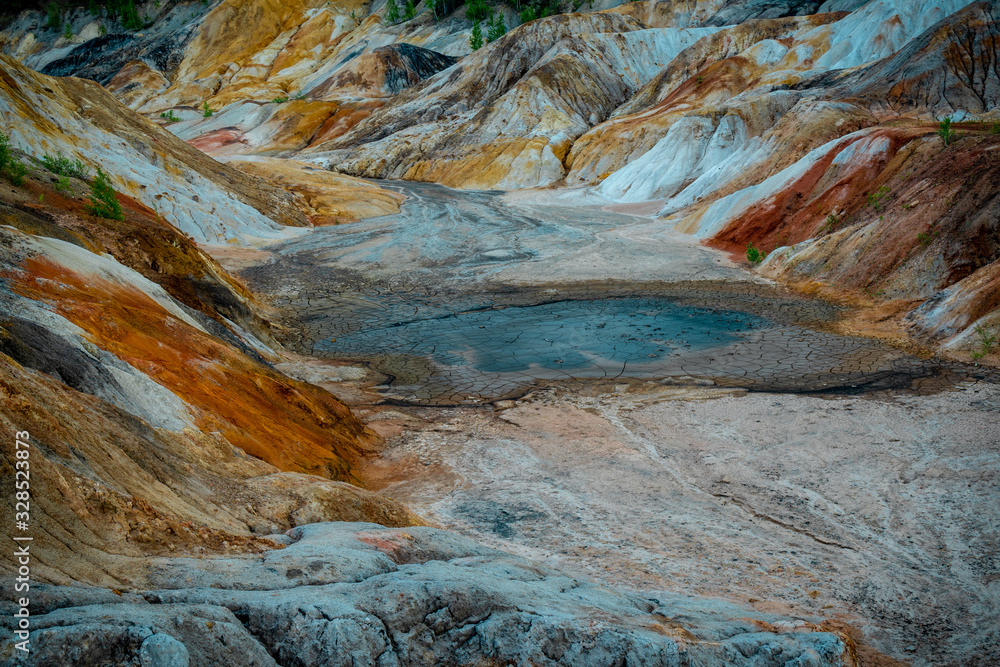 Fototapeta Mudflow clay - sand, flowing down from the mountains with water after heavy rains, natural phenomena and disasters. rock