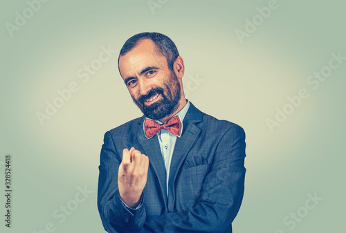 Photo Man showing come here with index finger gesture