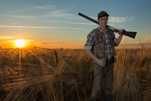 Male Hunter With A Rifle On A ...