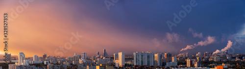 Fototapeta Dawn clouds over the metropolis of early sunset 9 obraz