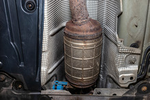 A Diesel Particulate Filter In The Exhaust System In A Car On A Lift In A Car Workshop, Seen From Below.
