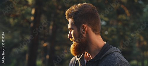 Fotografie, Obraz Close up portrait of confident bearded man in a autumn park