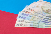 Romanian Banknotes On A Blue A...