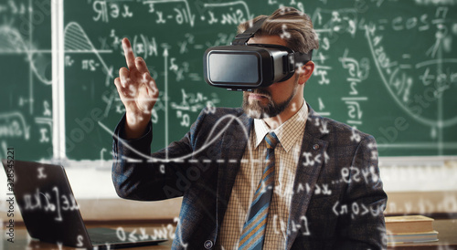 Portrait of bearded teacher in formal attire wearing virtual reality headset and Canvas Print