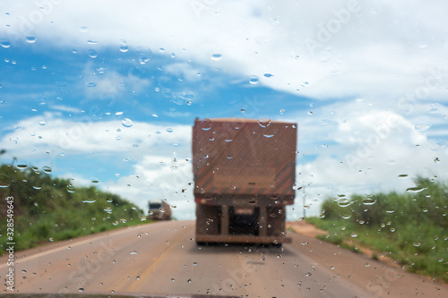 Close up of raindrops on a truck glass on the BR 163 road in the Amazon on a sunny summer day Tapéta, Fotótapéta