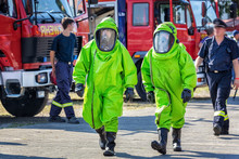 Two Firefighters In Protective Suit For Hazardous Material During A Public Demonstration