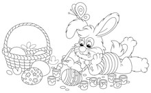 Happy Little Bunny Painting Beautiful Easter Eggs With Bright And Colorful Paints And An Art Paintbrush, Black And White Vector Cartoon Illustration For A Coloring Book