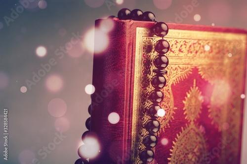Islamic Book Koran with rosary on desk Wallpaper Mural