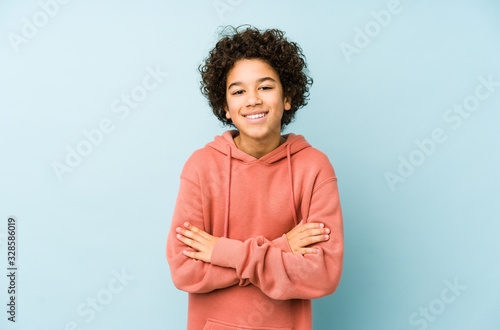 Fototapeta African american little boy isolated laughing and having fun. obraz