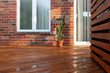 canvas print picture - Backyard wooden deck floor boards with fresh brown stain