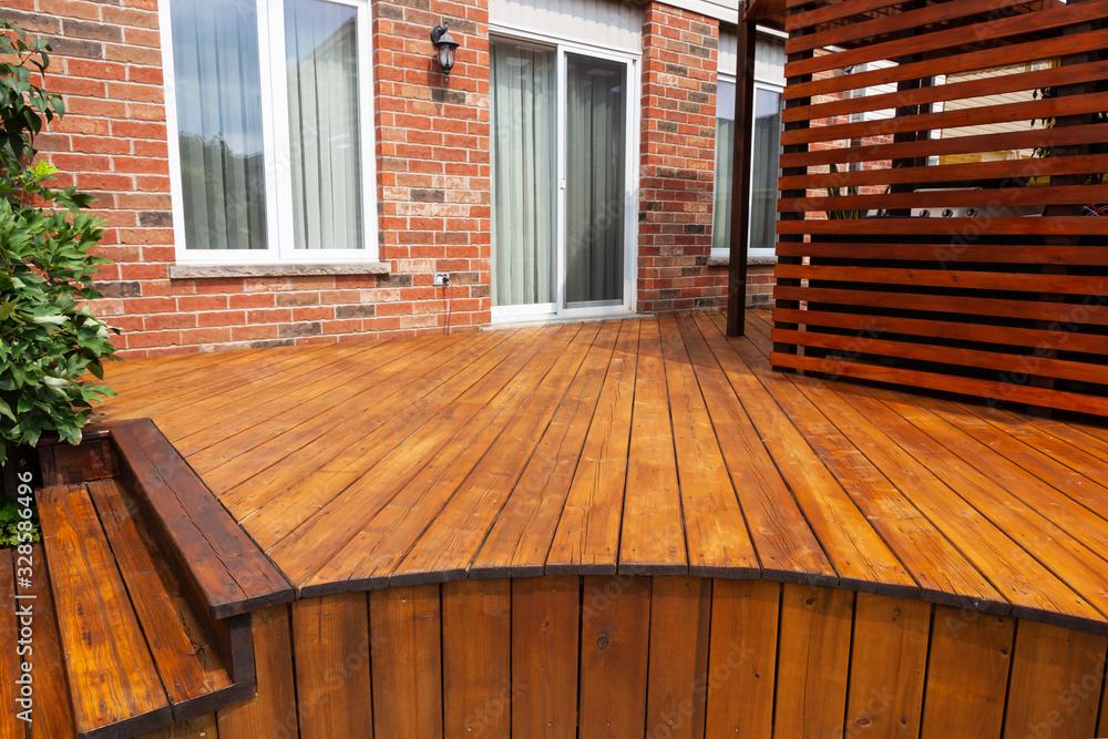 Fototapeta Backyard wooden deck floor boards with fresh brown stain - obraz na płótnie
