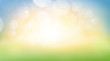 A fresh spring, summer sunny blue sky background with blurred warm bokeh glow.