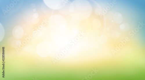 Fotografiet A fresh spring, summer sunny blue sky background with blurred warm bokeh glow