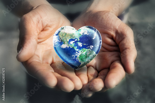 Hand holding Heart Shape Earth, Love Green Enviroment and Earth Day concept, Elements of this image furnished by NASA