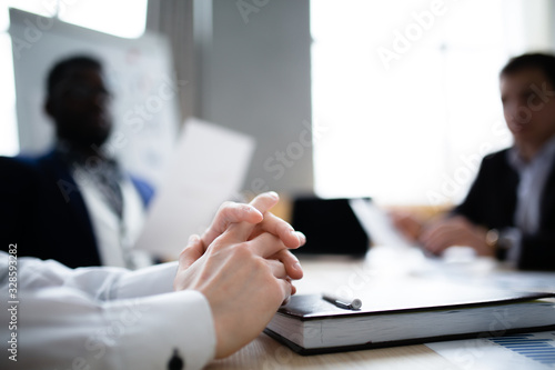 An approximate photo of the hands of a businessman with a diary on a blurred bac Wallpaper Mural