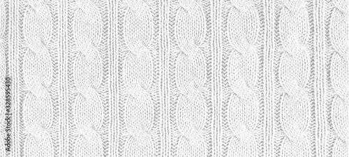 White knitted textured background, panorama, banner with a pattern, acrylic and cotton knit fabric, closeup