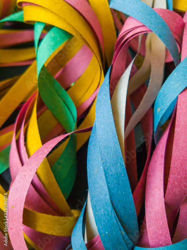 Fototapety, obrazy: Very colorful Brazilian carnival streamers, are made of recycled paper and last for only one party.