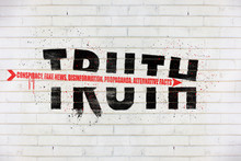 The Word Truth With An Arrow Of Conspiracy, Fake News, Disinformation, Propaganda, Alternative Facts, Painted On Old White Wall, Truth Being Destroyed Concept Illustration