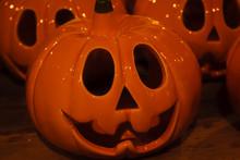 Shiny Halloween Pumpkin Made Of Ceramic. Carved Ceramic Pumpkin.