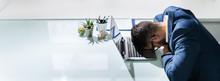 Businessman Sleeping At Desk I...